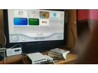 Fairly new nintendo wii vti wifi with 5 games fully working
