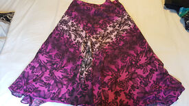 3 M&S skirts: all size 14, all over-knee length: 1 purple/pink, 1 green/blue, 1 black, all comfy!