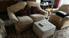 Two seated cream settee and two chairs