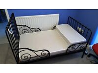 childs metal frame adjustable bed from Ikea . Mattress included