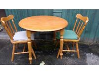Solid pine circular table + 2 chairs