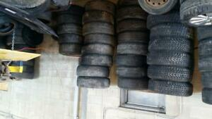 LOT OF RIMS WITH TIRES ALL SIZES AND SEASON