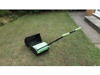 A Handy hand pushed lawn mower. Ideal for a small garden.