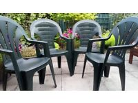Garden chairs, dark green plastic stackable and sturdy.
