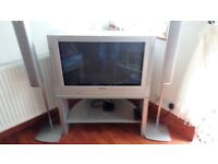 panasonic tv with stand and speakers and digi box