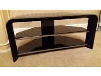 "TV stand 3 black glass shelves. Very good condition. 37"" W & 17"" D. Cash and collection only."