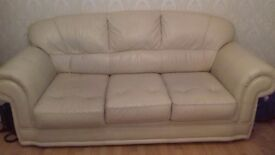 Cream solid wood 3 seat sofa and armchair.
