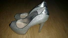 Silver size 5, heels by Guess