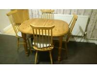 Wooden extending dining table and 4 chairs