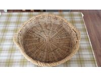 Unique large round shallow strong wicker fruit or bread basket with handles and rope