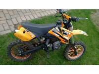 Orange mini moto dirt bike