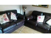 One 2 seater and one 3 seater real leather sofas