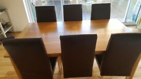 Hardwood dining table and 6 leather chairs