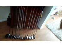 Set of golf clubs, 3 woods, 10 irons and 1 putter.