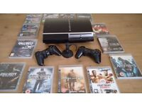 PlayStation 3 with 13 games two controllers and ear piece