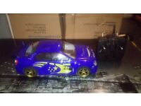 RC NITRO 1.10 SCALE SUBARU CAR 2 GEARS VERY FAST AND ALL SET UP TO GO, VERY CLEAN CAR