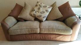 A beautiful sofa and large arm chair immaculate condition