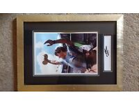Diego Maradona signed photograph holding 1986 World Cup in Mexico City