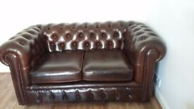 Brown leather Chesterfield sofa.
