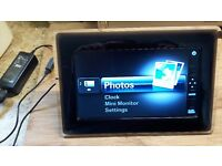 Samsung Photo frame BT08PS with 4GB SD card included. Original power unit. Tested fully working