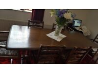 Dark oak dining room table and 6 chairs