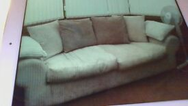 cream sofa and large armchair