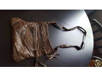 Small tan leather satchel