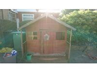 Wooden Playhouse in need of renovation.