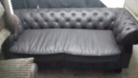 Chesterfield style brown faux leather 3str sofa.