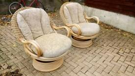 A pair of rocking and swivelling conservatory chairs