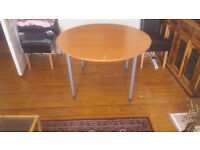 Used Ikea round table 118cm in diameter with height adjustable legs.Can be flat packed.