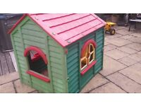 Wendy's plastic play house outdoors garden