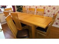 Table and 8 Chairs ( table extends out from 7ft to up to 13ft)