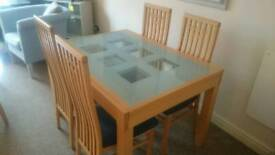 Solid wood extending table and chairs