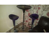 2 adjustable purple stools and 1 black adjustable table