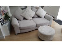 Evoke light grey 3 seater Sofa. Has chrome legs fitted with gliders. Matching round flower stool.