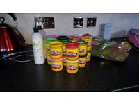 Tubs of unused play doh and 2 x bottles of glue