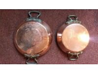 2 matching French twin handled copper pans.