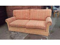 Orange fabric patterned 2 seater sofa