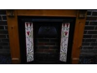 Cast iron fireplace with pine surround .