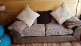 3 seater jumbo cord fabric sofa with brown faux base