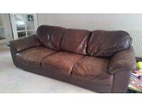 X2 brown leather sofas from dfs