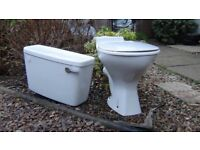 Toilet with all cistern fittings