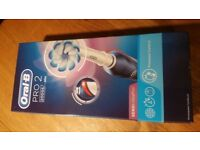 Oral B Pro 2 Electric Toothbrush Still in box brand new and never used - but missing brushhead