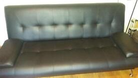 Black leather click clack sofaBed