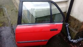 BMW e30 saloon rear passenger side door in red