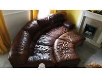Distressed leather curved corner sofa