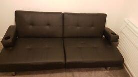 Black DFS sofa bed.