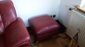 Red two seater sofa and foot stool
