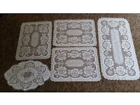 Lace table mats and cloths